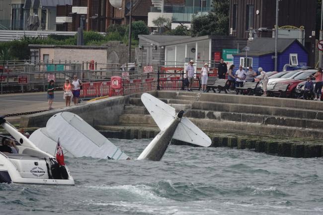 Wingwalker plane crashes in Poole Harbour
